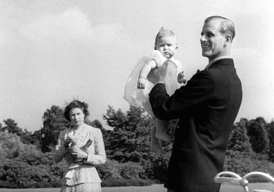 <p>Baby Prince Charles being lifted up by his father The Duke of Edinburgh in 1949 (PA) </p>