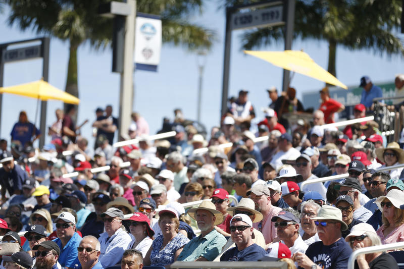 VARIOUS CITIES, - MARCH 12: Fans look on during the bottom of the fifth inning of a Grapefruit League spring training game between the Washington Nationals and the New York Yankees at FITTEAM Ballpark of The Palm Beaches on March 12, 2020 in West Palm Beach, Florida. Many professional and college sports, including the MLB, are canceling or postponing their games due to the ongoing threat of the Coronavirus (COVID-19) outbreak. (Photo by Michael Reaves/Getty Images)