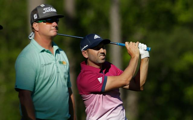 <span>Charley Hoffman looks on as Sergio Garcia plays an approach shot on the 17th</span>