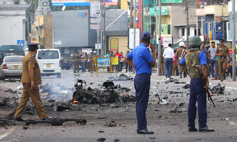 Sri Lankan security personnel inspect the debris of a car after it explodes when police tried to defuse a bomb near St. Anthony's Shrine in Colombo, Sri Lanka on April 22, 2019, a day after the series of bomb blasts targeting churches and luxury hotels in Sri Lanka. The death toll from bomb blasts that ripped through churches and luxury hotels in Sri Lanka rose dramatically on April 22, to 290. (Photo by Pradeep Dambarage/Pacific Press/Sipa USA)