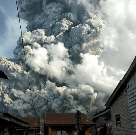 A volcanic ash cloud from Mount Sinabung hovers over Karo, North Sumatra