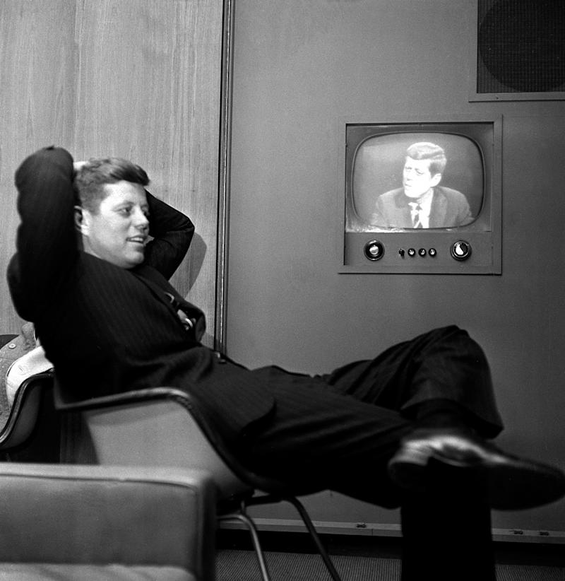 FILE - In this April 3, 1960 file photo, Sen. John F. Kennedy, Democratic presidential nominee, sits next to a playback of his televised appearance in Milwaukee, Wis. for the Wisconsin presidential primary two days later. (AP Photo)