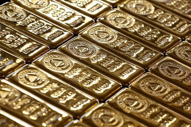 Gold prices fall marginally today in futures trade
