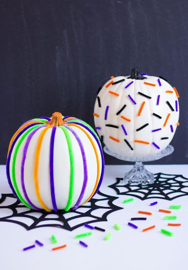 """<p>Mask any imperfections with a fresh coat of paint, and then add some personality with an array of colorful pipe cleaners. That's it!</p><p><em><a href=""""https://designimprovised.com/2018/10/pumpkin-week-pipe-cleaner-pumpkins.html"""" rel=""""nofollow noopener"""" target=""""_blank"""" data-ylk=""""slk:Get the tutorial at Design Improvised »"""" class=""""link rapid-noclick-resp"""">Get the tutorial at Design Improvised »</a></em></p>"""