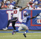 FILE - In this Sept. 21, 2014, file photo, Houston Texans wide receiver DeAndre Hopkins (10) pulls in a pass against New York Giants cornerback Prince Amukamara (20) in the second quarter of an NFL football game in East Rutherford, N.J. The one-handed catch by New York Giants' Odell Beckham Jr. that became the most talked-about play from Sunday, Nov. 23, 2014, did more than just boost his standing with the New York Giants, it paid off a routine growing popular among many skill players of practicing the impractical, one-handed circus grab. (AP Photo/Kathy Willens, File)