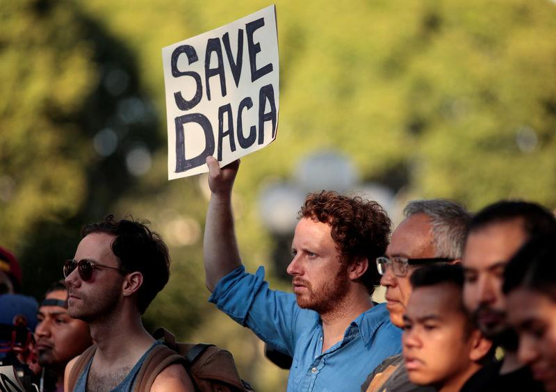 Supporters of the Deferred Action for Childhood Arrivals (DACA) program rally on Olivera Street in Los Angeles, California
