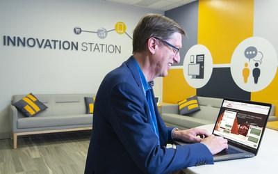 Greg Simpson, Chief Technology Officer and Artificial Intelligence leader at Synchrony, a premier consumer financial services company, chats with Synchrony's intelligent virtual assistant – Sydney. Trained in hundreds of topics from years of Synchrony call center data, Sydney helps answer cardholders' text-based questions and soon responds via voice. (Photo credit: Jon Simon/Feature Photo Service for Synchrony)