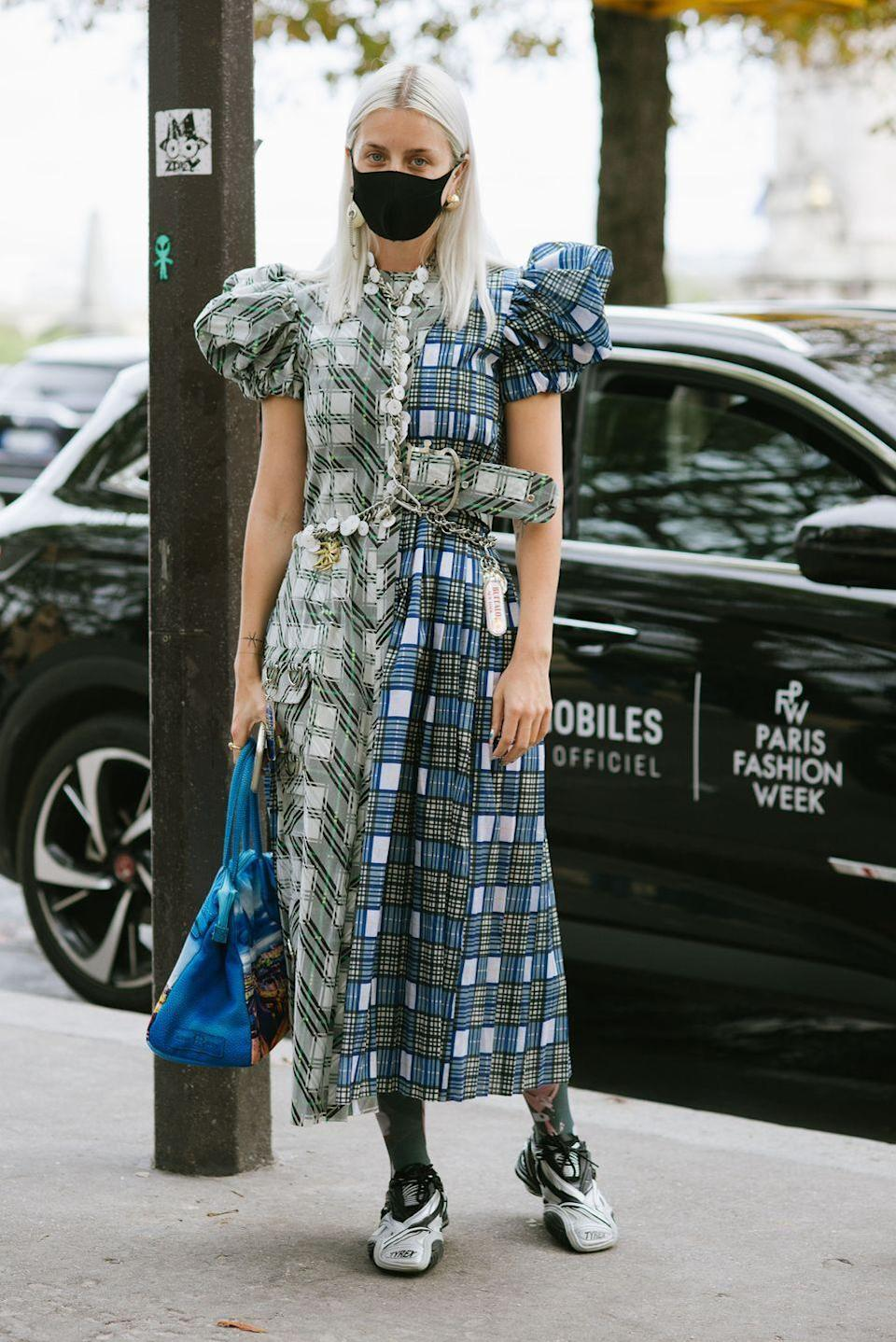 """<p>Our <a href=""""https://www.cosmopolitan.com/uk/fashion/style/g29031614/best-black-dress/"""" rel=""""nofollow noopener"""" target=""""_blank"""" data-ylk=""""slk:autumnal dresses"""" class=""""link rapid-noclick-resp"""">autumnal dresses</a> didn't get many chances to make an outing last year, so rework them for the coming warmer months. A tartan <a href=""""https://www.cosmopolitan.com/uk/fashion/style/a27403223/maxi-dresses-uk/"""" rel=""""nofollow noopener"""" target=""""_blank"""" data-ylk=""""slk:maxi dress"""" class=""""link rapid-noclick-resp"""">maxi dress</a> paired with layers of colourful beaded jewellery and chains, plus a bright patterned bag feels just as right for spring. </p>"""