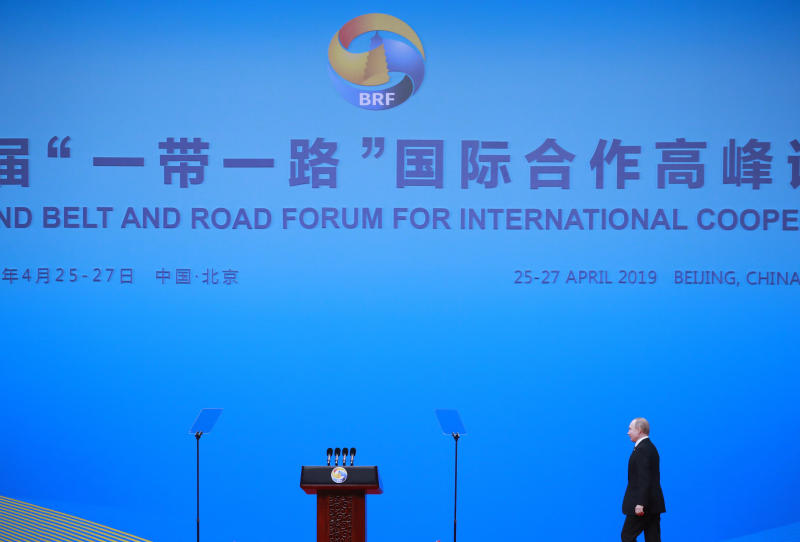 Russian President Vladimir Putin walks on stage to deliver his speech at the opening ceremony of the second Belt and Road Forum for International Cooperation (BRF) in Beijing Friday, April 26, 2019. (How Hwee Young/Pool Photo via AP)