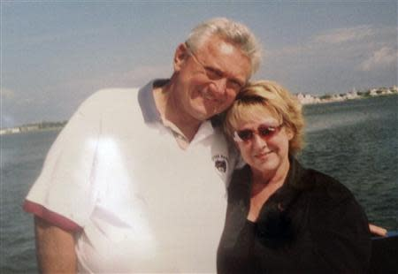 John Roger Johnson, 73, of Derwood, Maryland, is seen with his wife, Judy, in this undated family handout picture. Johnson was named as one of the 12 victims killed after suspected gunman Aaron Alexis opened fire at the Washington Navy Yard on Monday. REUTERS/Courtesy of the Johnson Family/Handout