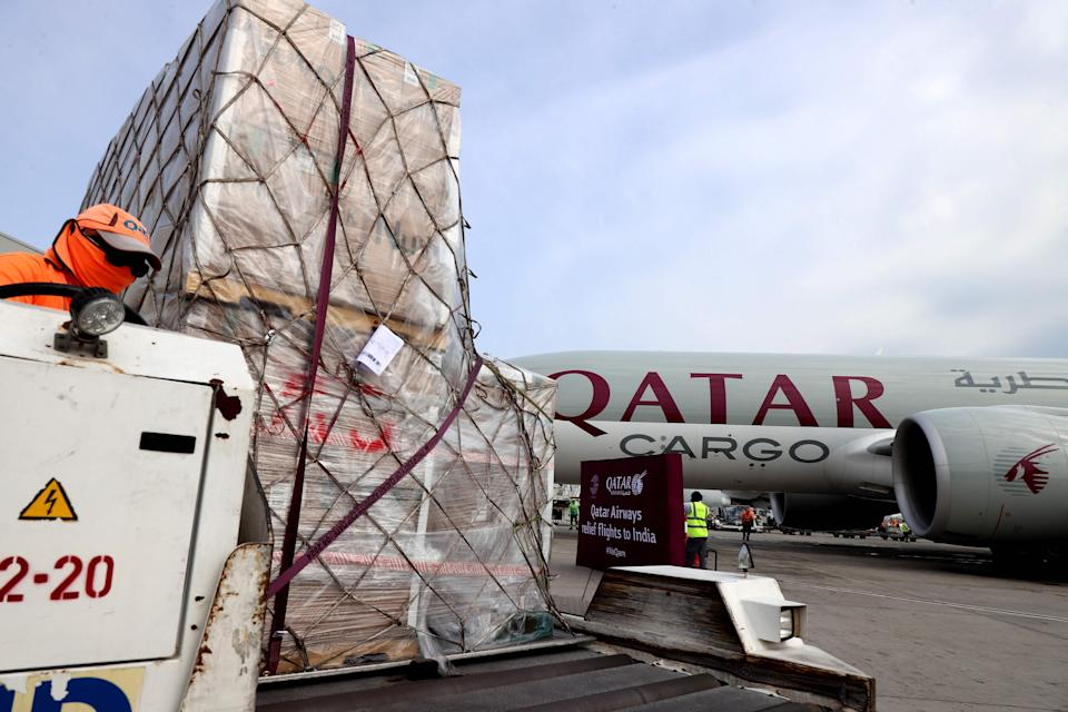 <p>Workers load 300 tonnes of medical aid to be flown in a three-flight cargo aircraft convoy directly to destinations in India</p> (AFP via Getty Images)