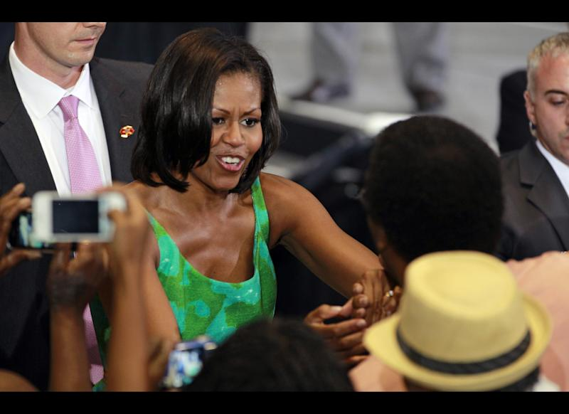First lady Michelle Obama greets supporters after a campaign event for her husband, President Barack Obama at the University of Central Florida, Tuesday, July 10, 2012, in Orlando, Fla.
