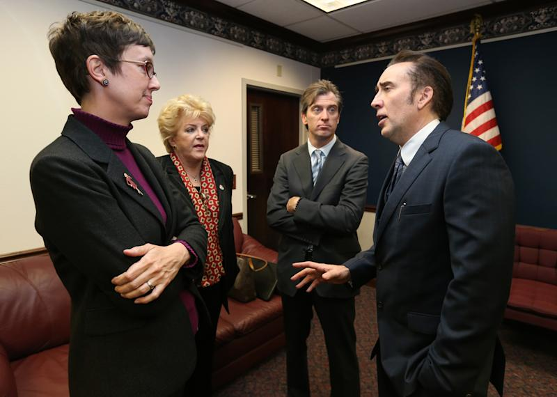 From left, Nevada Assemblywoman Heidi Swank, D-Las Vegas, Las Vegas Mayor Carolyn Goodman, Michael Nilon and actor Nicholas Cage talk at the Legislative Building Carson City, Nev., on Tuesday, May 7, 2013. Goodman, Nilon and Cage testified in support of a measure that would offer tax incentives to filmmakers in an effort to bring jobs and revenue to the state. (AP Photo/Cathleen Allison)