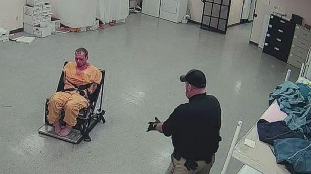 PHOTO: In this screen grab taken from a video, Pike County Sheriff Jeremy Mooney is shown with restrained prisoner, Thomas Friend. (WSYX)