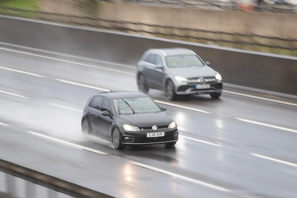 Cars travel along the M1 motorway through wet and windy weather. (Photo by Aaron Chown/PA Images via Getty Images)