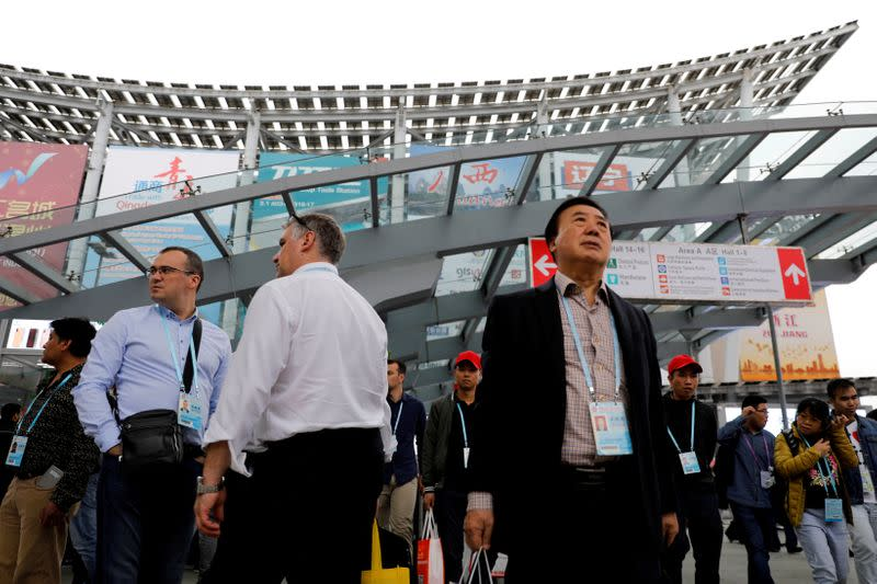FILE PHOTO: Visitors attend the China Import and Export Fair, also known as Canton Fair, in the southern city of Guangzhou