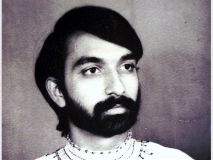 "Collect photo of Dr Manoj Joshi as a young man. See SWNS story SWLEmoustache; A man who shaved his moustache to raise funds for a polio vaccine says his wife can't even recognise him - after he trimmed it for the first time in 52 YEARS. Dr Manoj Joshi, 68, says he had never shaved his moustache ever since he could grow one as a fresh faced 16-year-old but decided to chop it all off in a bid to ""eradicate polio"". But after he chopped it off his shocked wife said she couldn't recognise him as she'd never seen him without it in the 42 years they had been married. The grandfather-of-two joked that it would take a lawn mower to trim his luscious facial hair - which is older than the invention of the mobile phone. Dr Joshi, a proud Rotarian, which is a worldwide charitable society with over a million members worldwide, has been involved in what he calls ""acts of giving"" for his entire life. On World Polio Day (Saturday, Oct 24) he took centre stage at a park in front of Bradford City Hall to shave off his beloved moustache in an ""emotional day""."