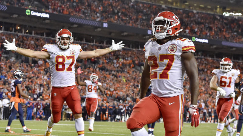 Kansas City Chiefs running back Kareem Hunt runs into the end zone for a fourth quarter touchdown as tight end Travis Kelce celebrates during Monday's football game against the Denver Broncos on Oct. 1, 2018 at Mile High Stadium in Denver. The Chiefs won 27-23. (John Sleezer/Kansas City Star/TNS via Getty Images)