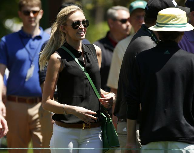 Paulina Gretzky follows her fiance, golfer Dustin Johnson (not shown), as he plays during the first round of the 2014 Masters golf tournament at the Augusta National Golf Club in Augusta, Georgia April 10, 2014. REUTERS/Jim Young (UNITED STATES - Tags: SPORT GOLF)