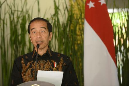 Indonesia president Joko Widodo speaks to journalist after bilateral meeting with Singapore during the International Monitary Fund and World Bank annual meetings in Nusa Dua