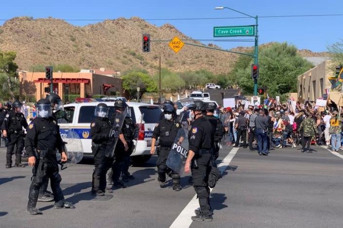 Police assemble before dispersing protesters during the visit by U.S. President Donald Trump to the Dream City Church in Phoenix