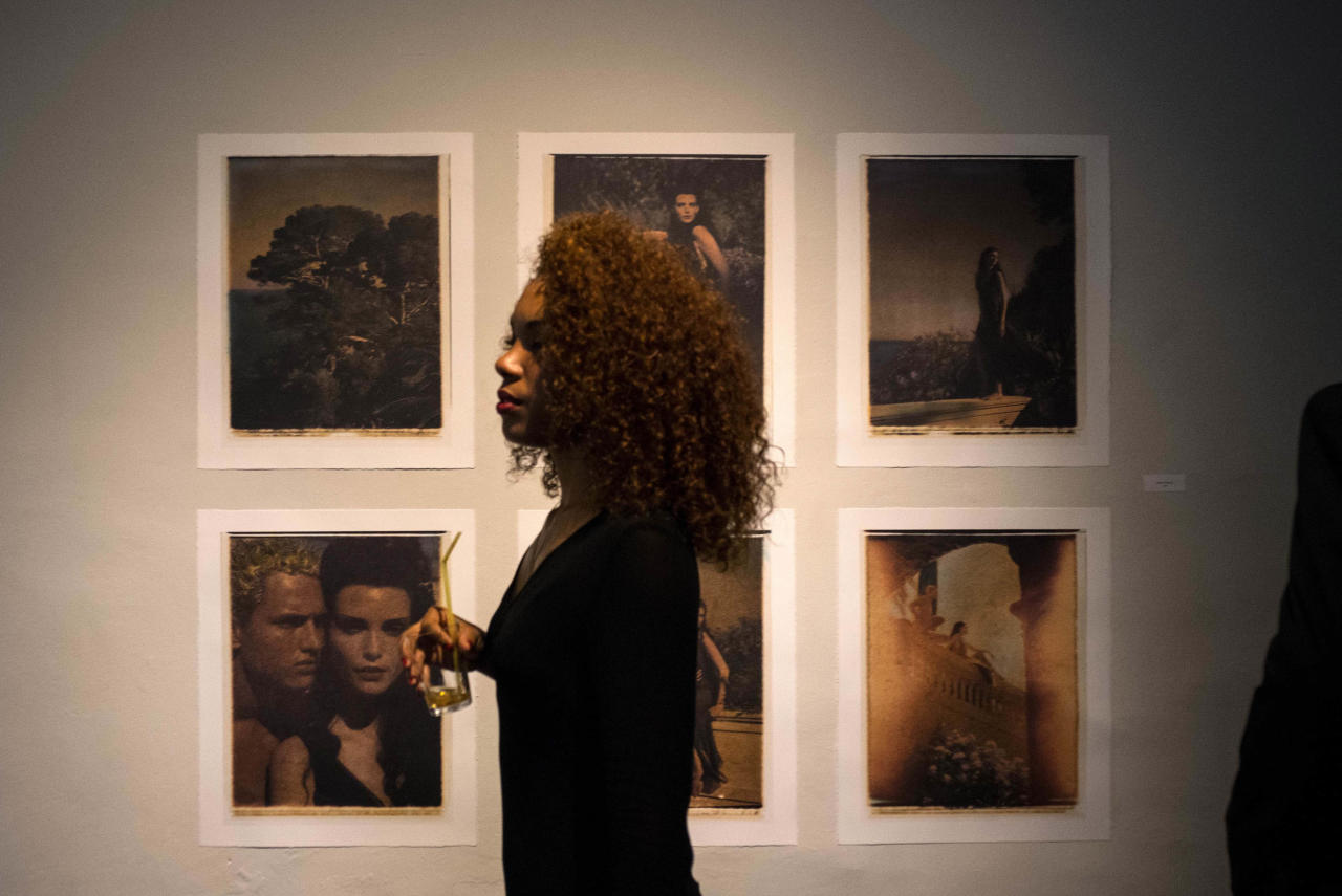 """A woman attends the Karl Lagerfedl exhibition """"Work in Progress"""" in Havana, Cuba,Sunday, May 1, 2016. After Lagerfeld, Chanel will present a fashion show with the collection """"Cruise"""" next May 3 in Havana. (AP Photo/Ramon Espinosa)"""