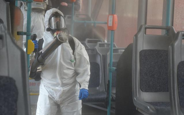 Staff are pictured disinfecting a tram in St Petersburg on 19 March. Russia has had 147 cases. (Getty Images)