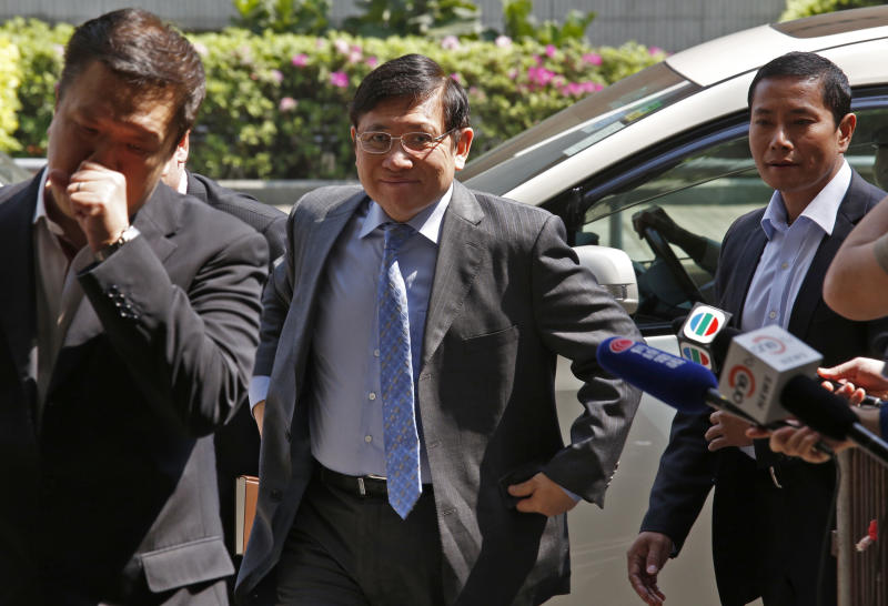 Sun Hung Kai Properties Ltd. Joint Vice Chairmen and Managing Director Raymond Kwok arrives at the Eastern Court in Hong Kong Friday, March 8, 2013. Billionaire property brothers Thomas and Raymond Kwok are at the center of a Hong Kong graft probe have pleaded not guilty to corruption charges. The Kwoks were arrested by anti-corruption police and charged last year along with a former senior government official and two others. The brothers are joint chairmen of Sun Hung Kai Properties, one of the city's biggest developers. (AP Photo/Vincent Yu)