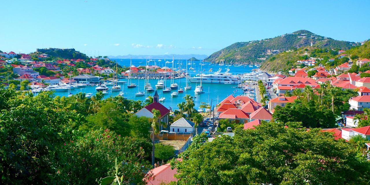 "<p><a href=""https://www.bestproducts.com/fun-things-to-do/g21237324/most-beautiful-islands-in-the-world/"" target=""_blank"">Saint-Barthélemy</a>, or St. Bart's, in the French West Indies, has long been an exclusive playground for the rich and famous (it's made a <a href=""https://observer.com/2018/12/st-barths-hotels-book-now-caribbean-travel-vacation/"" target=""_blank"">remarkable comeback</a> after recent hurricanes), who dock their yacht in the harbor, swim in beaches like Grand Salines, and stroll in the cutesy capital of Gustavia, filled with designer boutiques and chic cafés straight out of St. Tropez. </p>"