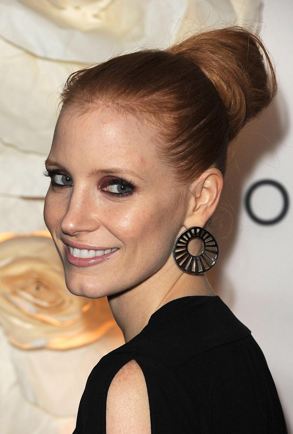 <p>Chastain had a smoothed, structured bun for a 2011 event.</p>