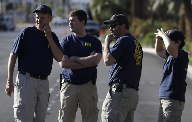 <p>FBI investigators observe the scene of a shooting near the Mandalay Bay casino, Tuesday, Oct. 3, 2017, in Las Vegas. (Photo: John Locher/AP) </p>