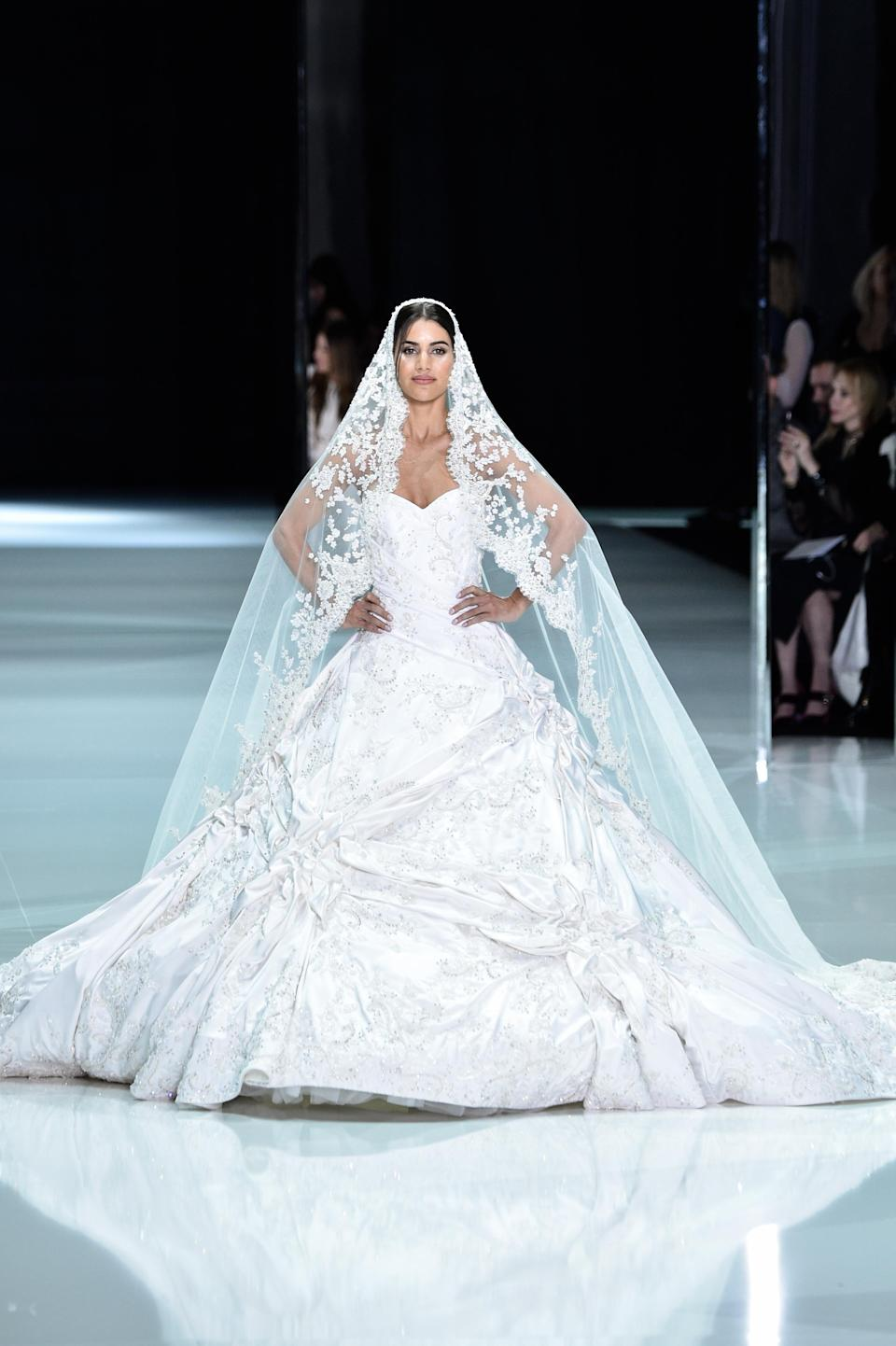 <p>This is the Ralph & Russo bridal gown infinitely more fitting of a Royal Wedding steeped in tradition than the previous one. (Photo: Getty Images) </p>