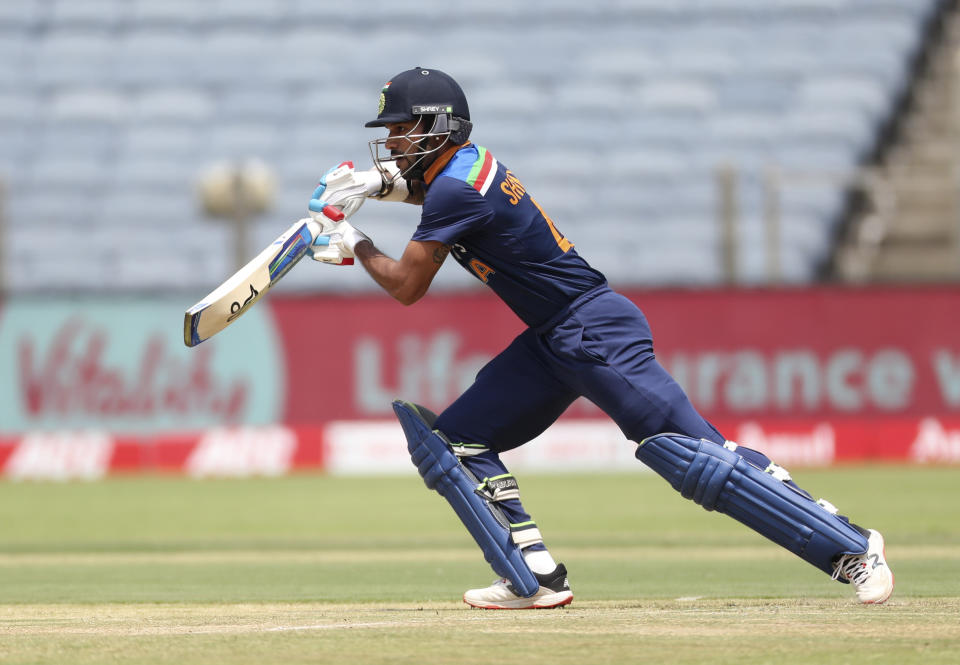 Indian cricketer Shikhar Dhawan bats during the second one-day international cricket match between India and England in Pune, India, Friday, March 26, 2021. (AP Photo/Rafiq Maqbool)