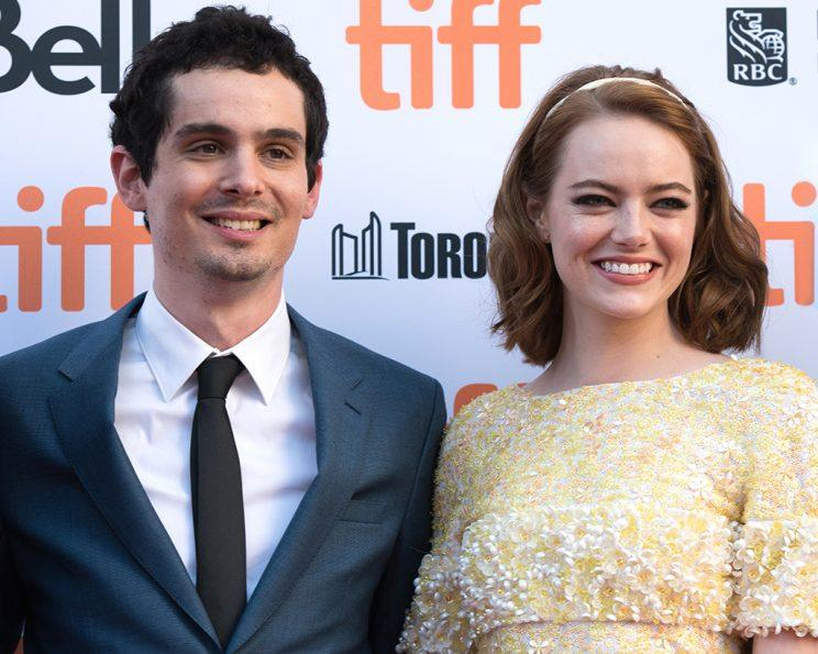 Director Damien Chazelle and Emma Stone attend the premiere of