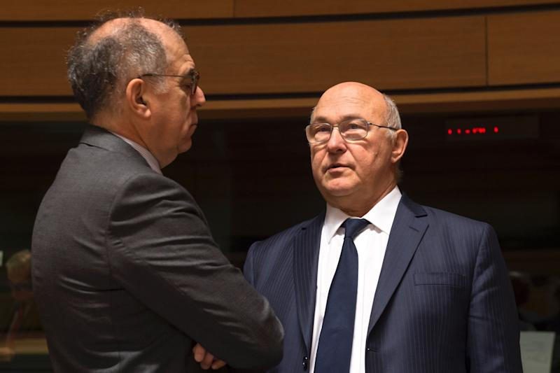 France's Ambassador to the European Union, Pierre Sellal (L) talks with French Finance minister Michel Sapin during an Ecofin EU finance ministers meeting in Luxembourg on October 11, 2016. / AFP / JOHN THYS (Photo credit should read JOHN THYS/AFP/Getty Images)