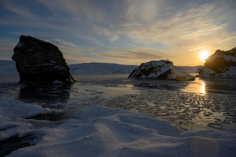 The temperature above the frozen lake of Kleifarvatn, one of country's deepest, is minus six degrees Celsius (21.2 degrees Fahrenheit) (AFP Photo/Halldor KOLBEINS)