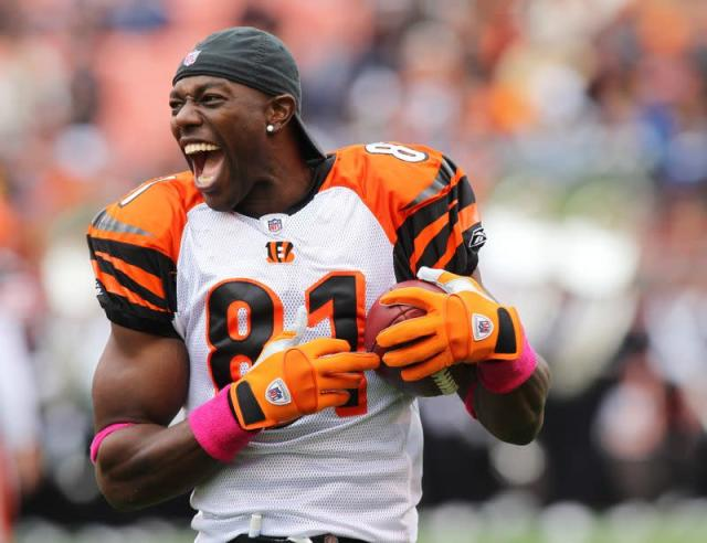 Bengals receiver Owens laughs while warming up prior to his NFL football game against the Browns in Cleveland