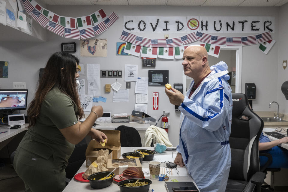 HOUSTON, TX - NOVEMBER 26: (EDITORIAL USE ONLY) Dr. Joseph Varon eats a meal in the nursing station in the COVID-19 intensive care unit (ICU) during Thanksgiving at the United Memorial Medical Center on November 26, 2020 in Houston, Texas. According to reports, Texas has reached over 1,220,000 cases, including over 21,500 deaths.  (Photo by Go Nakamura/Getty Images)