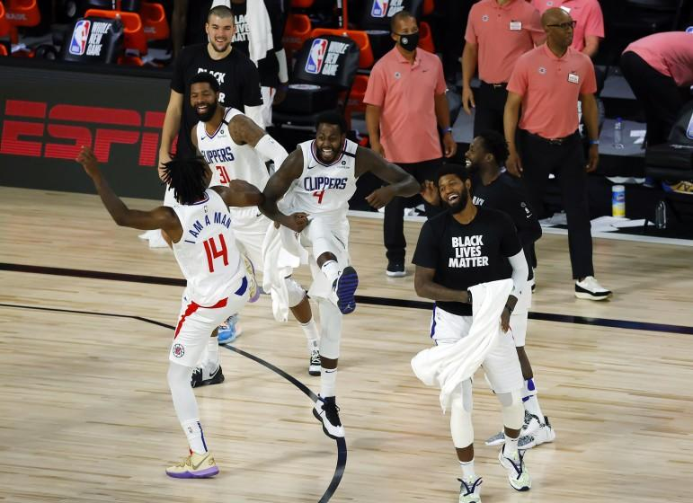Members of the Los Angeles Clippers celebrate after breaking a team three-point record during an NBA basketball game against the New Orleans Pelicans, Saturday, Aug. 1, 2020, in Lake Buena Vista, Fla. (Kevin C. Cox/Pool Photo via AP)