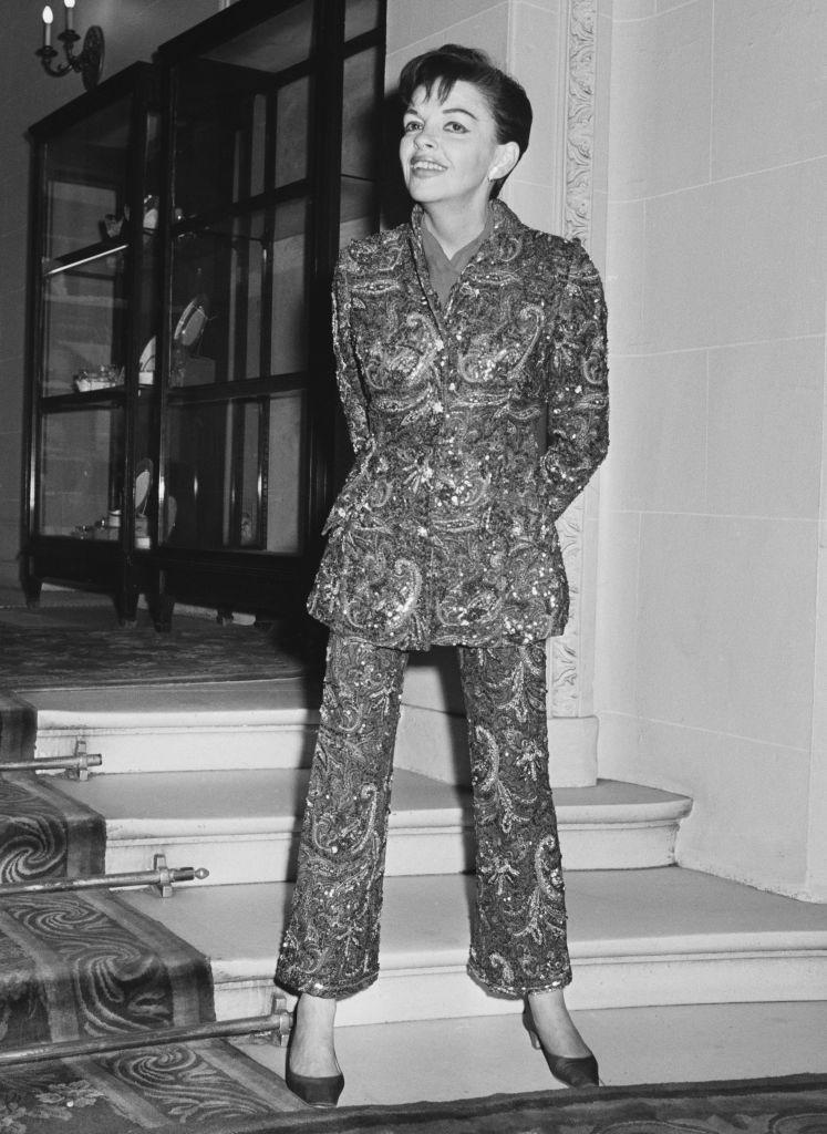 <p>A beaded and embellished suit sparkles on a short-haired Garland as she steps out in low heels for an evening on the town. </p>