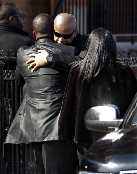 Bobby Brown, left, is greeted outside during the funeral of his ex-wife Whitney Houston at New Hope Baptist Church in Newark, N.J., Saturday, Feb. 18, 2012. Houston died last Saturday at the Beverly Hills Hilton in Beverly Hills, Calif., at the age 48. (AP Photo/Mel Evans)