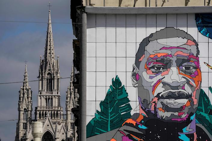 A picture taken on June 19, 2020, in Brussels shows a mural by Belgian street artist NovaDead paying tribute to George Floyd.