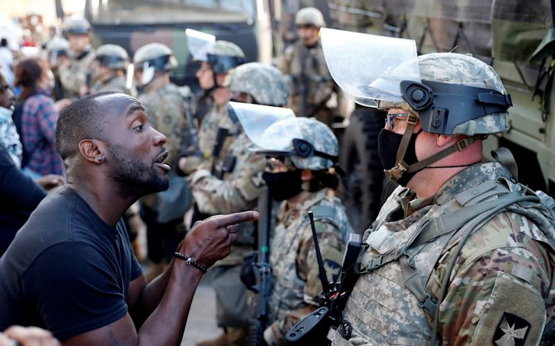 A man confronts a National Guard member during protests in Minneapolis - LUCAS JACKSON/REUTERS