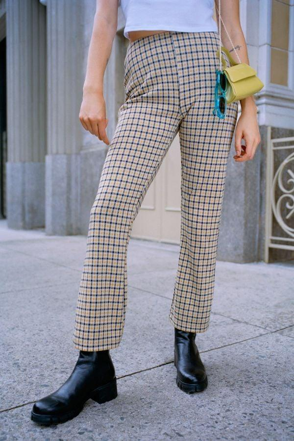 """<p>Wear these <a href=""""https://www.popsugar.com/buy/UO-Cara-High-Rise-Kick-Flare-Pants-472599?p_name=UO%20Cara%20High-Rise%20Kick%20Flare%20Pants&retailer=urbanoutfitters.com&pid=472599&price=39&evar1=fab%3Auk&evar9=46516844&evar98=https%3A%2F%2Fwww.popsugar.com%2Ffashion%2Fphoto-gallery%2F46516844%2Fimage%2F46517322%2FUO-Cara-High-Rise-Kick-Flare-Pants&list1=shopping%2Cfall%20fashion%2Cfall%2Curban%20oufitters&prop13=api&pdata=1"""" rel=""""nofollow"""" data-shoppable-link=""""1"""" target=""""_blank"""" class=""""ga-track"""" data-ga-category=""""Related"""" data-ga-label=""""https://www.urbanoutfitters.com/shop/uo-cara-high-rise-kick-flare-pant?category=womens-new-arrivals&amp;color=079&amp;type=REGULAR"""" data-ga-action=""""In-Line Links"""">UO Cara High-Rise Kick Flare Pants</a> ($39) with your favorite ankle boots.</p>"""