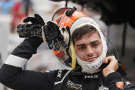 Rinus VeeKay, of the Netherlands, takes off his helmet during qualifications for the Indianapolis 500 auto race at Indianapolis Motor Speedway, Saturday, May 22, 2021, in Indianapolis. (AP Photo/Darron Cummings)