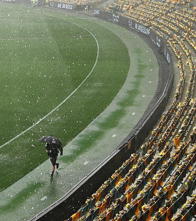 Heavy rain, pictured here hitting Brisbane before the 2020 AFL grand final at the Gabba.