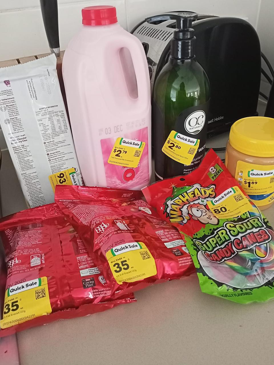 Shopper's Woolworths haul for less than $10 shown.