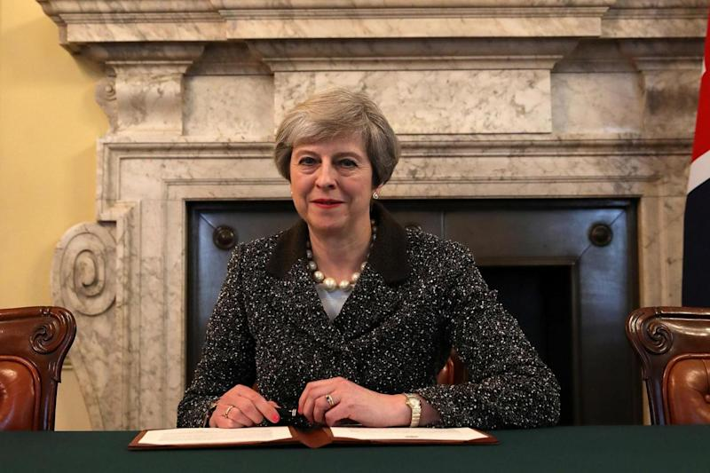 PM Theresa May in the cabinet office signs the official letter to European Council President Donald Tusk. (REUTERS)