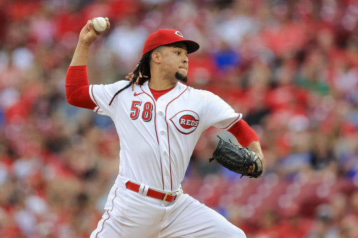 Cincinnati Reds' Luis Castillo throws during the first inning of the team's baseball game against the Milwaukee Brewers in Cincinnati, Saturday, July 17, 2021. (AP Photo/Aaron Doster)