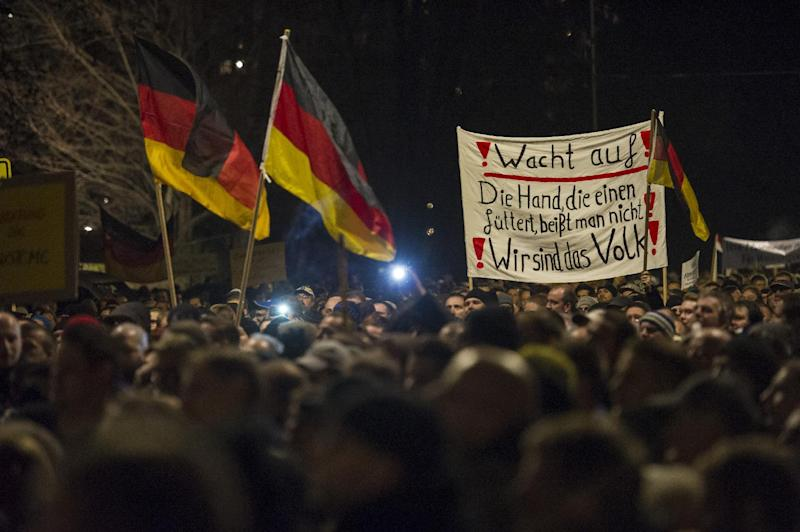 Supporters of the PEGIDA movement take part in a rally in Dresden on December 15, 2014 (AFP Photo/Jens Schlueter)